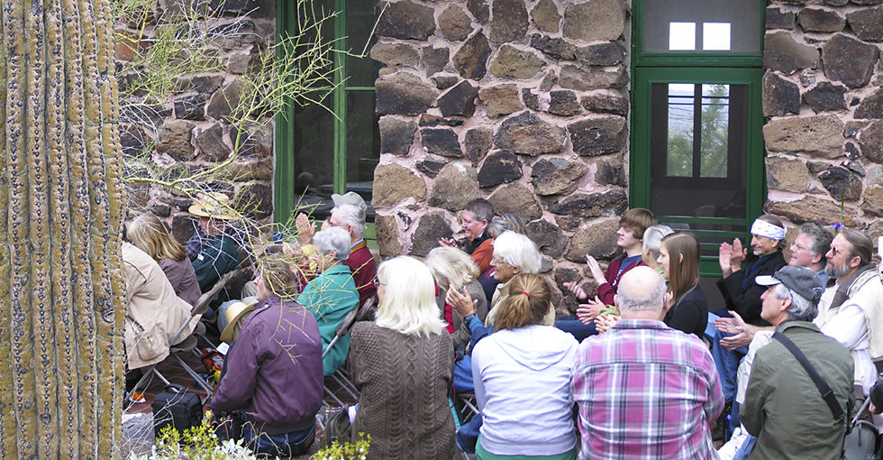 Friends of Paul Martin listen to speakers talking about his life on the Desert Lab patio.