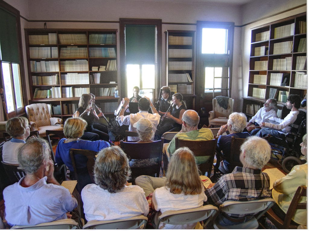 "a woodwind quintet premiers ""Tumamoc Hill"" in the Tumamoc library room,"