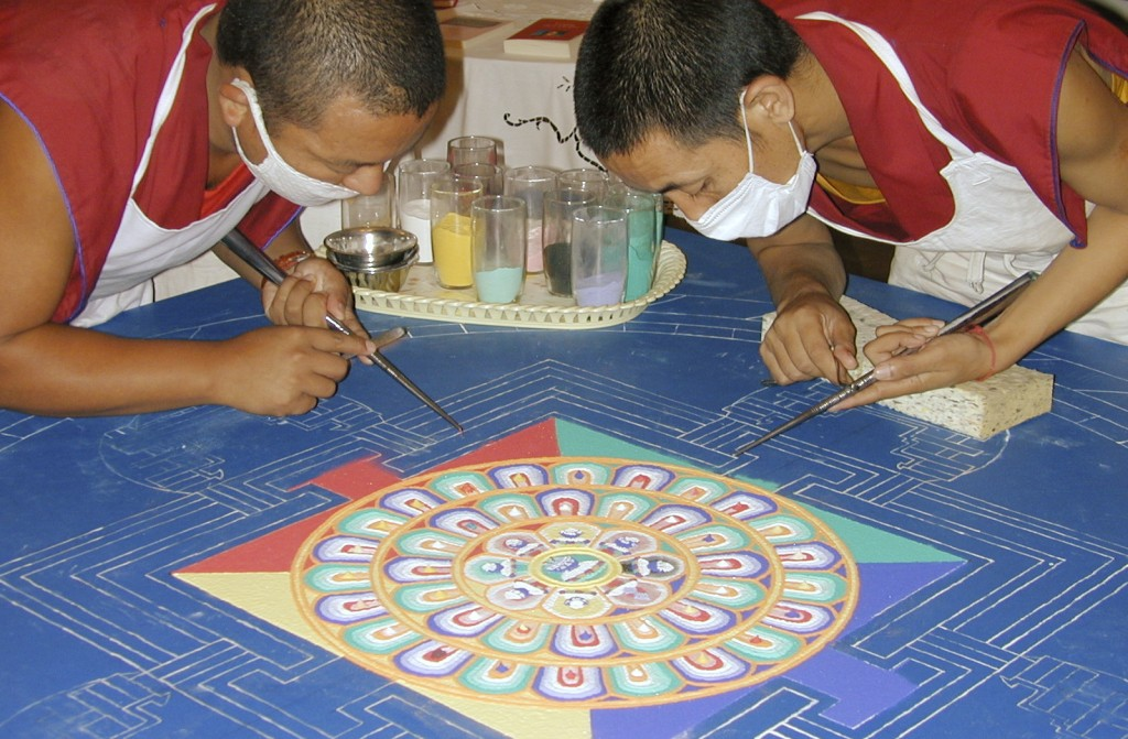Tibetan monks creating a sand mandala