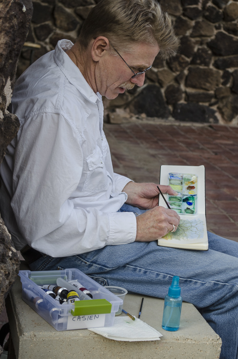 Bill Singleton painting in the patio garden